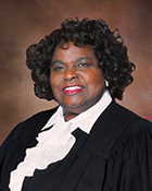 A headshot photo of a woman in a judge's robe