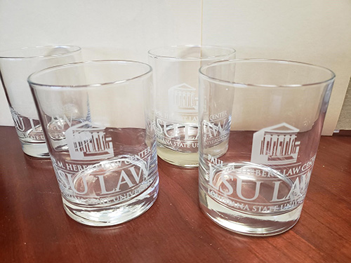 Four LSU Law etched glassware