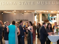A group of people interact with each other at the Capitol Park Museum