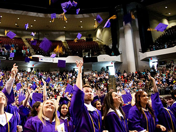 LSU students throwing their graduation caps