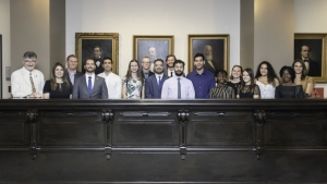 LLM and JD students behind the old Bench at the Louisiana Supreme Court Museum