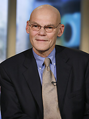 A bald man wearing glasses and a suit and tie