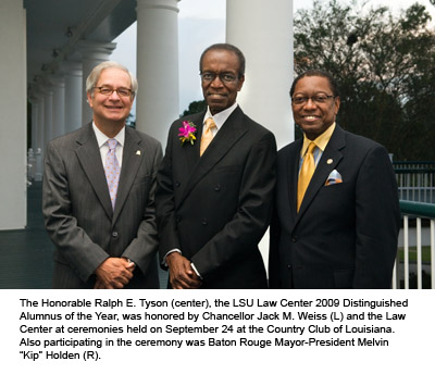 Three men in suits pose for a photo with white columns in the background