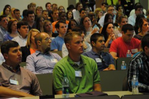 A group of students look to the right in the LSU Law auditorium