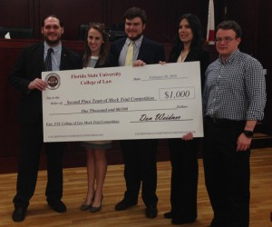 "Adam Ross, Rachel Stafford Day, Jeffery ""Beau"" Wheeler, and Ashley Knarr, with attorney coach Jason Hessick ('08)."