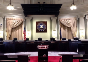 A courtroom with the Supreme Court of Louisiana seal on the wall