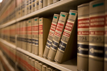 a row of law text books on a shelf