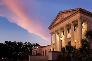 front of LSU Law Center at dusk with pink and purple cloud in background