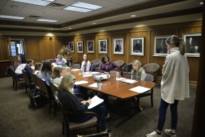 Middle District of Louisiana Magistrate Judge Erin Wilder-Doomes ('99), center, listens along with students as a presentation is given during her Exploring the Role of the Magistrate class