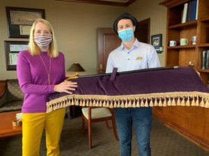 LSU Law Interim Dean Lee Ann Lockridge and 3L Class President Keifer Ackley present the cane that the very first class of graduating LSU Law students presented to Dean Joseph I. Kelly in 1908 during the virtual 2020 Hats 'n Canes Toast.