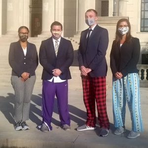 LSU Law American Bar Association Arbitration Competition team members Kaylin Jolivette, Payton Lachney, Chris Versak, and Hannah Dardar in front of the Law Center following their virtual competition on Saturday, Nov. 14.