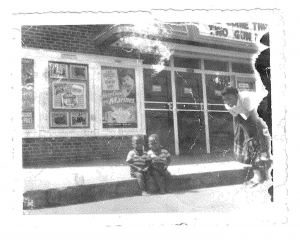 """Ron and Don Johnson as boys outside the Capitol Avenue Theater in the Eden Park area of north Baton Rouge. Ron says """"this sort of pictorially explains where and how far Judge Ron and I have come,"""" noting the boys were shoeless in the photo. The Jim Crow-era, Black-only theater was demolished in the late 1950s and the St. Paul Catholic Church now sits on the site."""